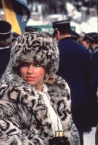 woman in fur coat made from a snow leopard pelt