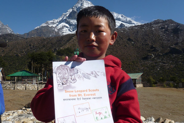 boy holding booklet
