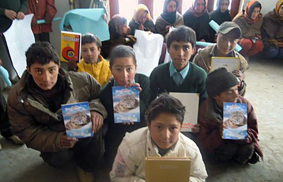 students with snow leopard book