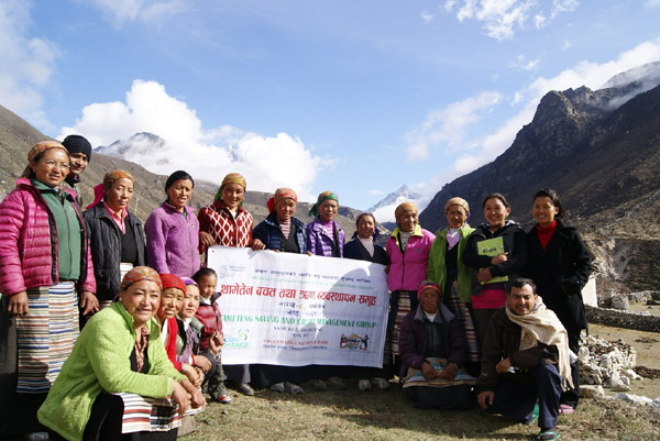 Villagers with sign in Nepalese