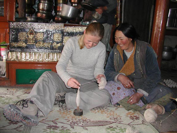 two women spinning wool