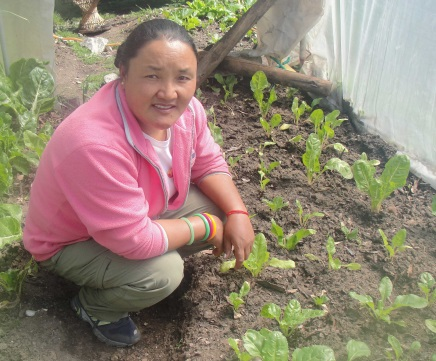Ang Maya by her garden