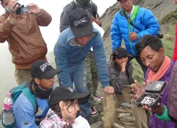 Ramesh showing several students a camera trap