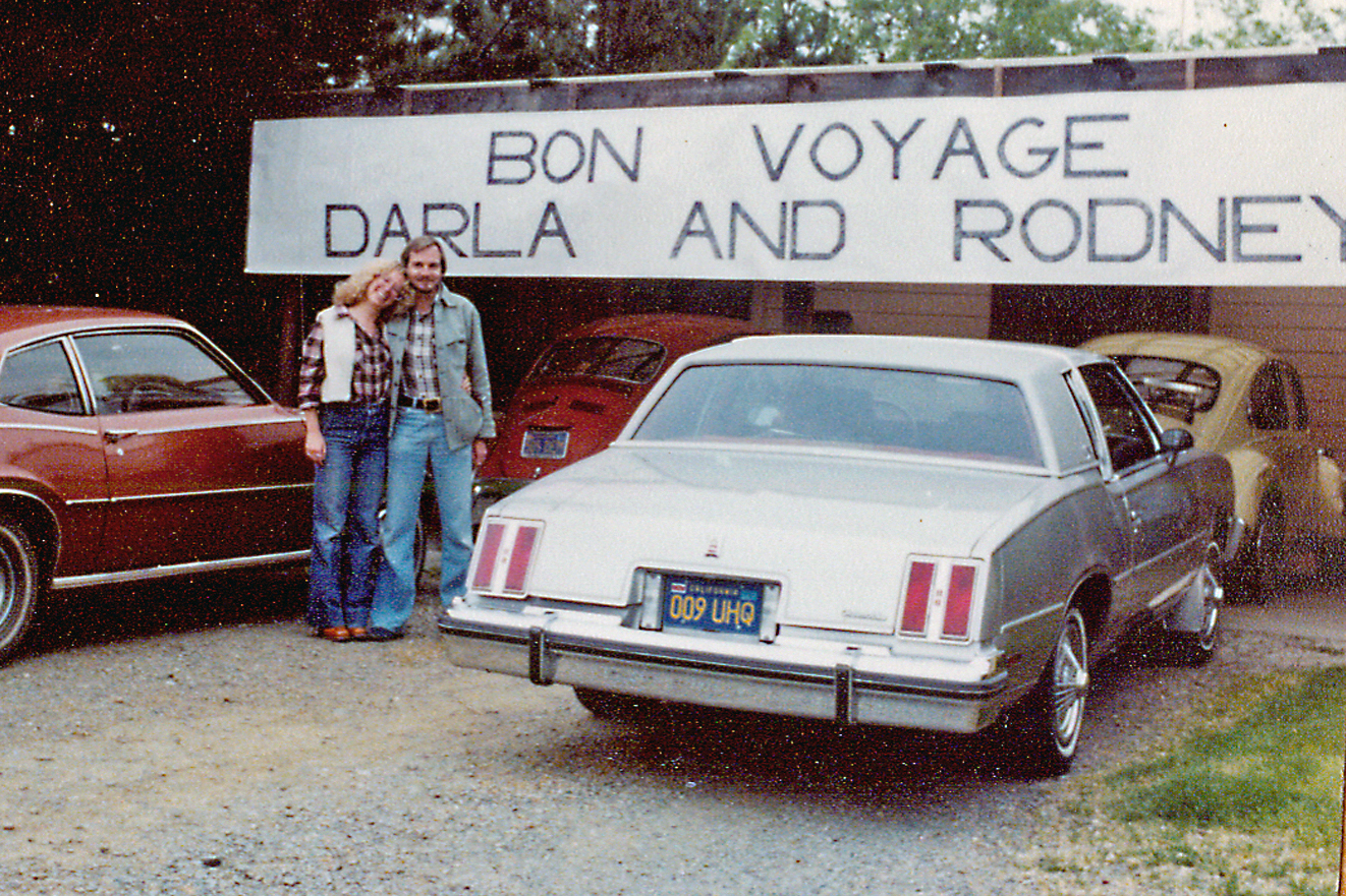 Rodney and Darla near Bon Voyage sign