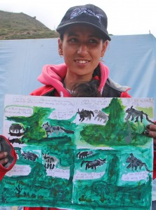 female scout holding painting of wildlife