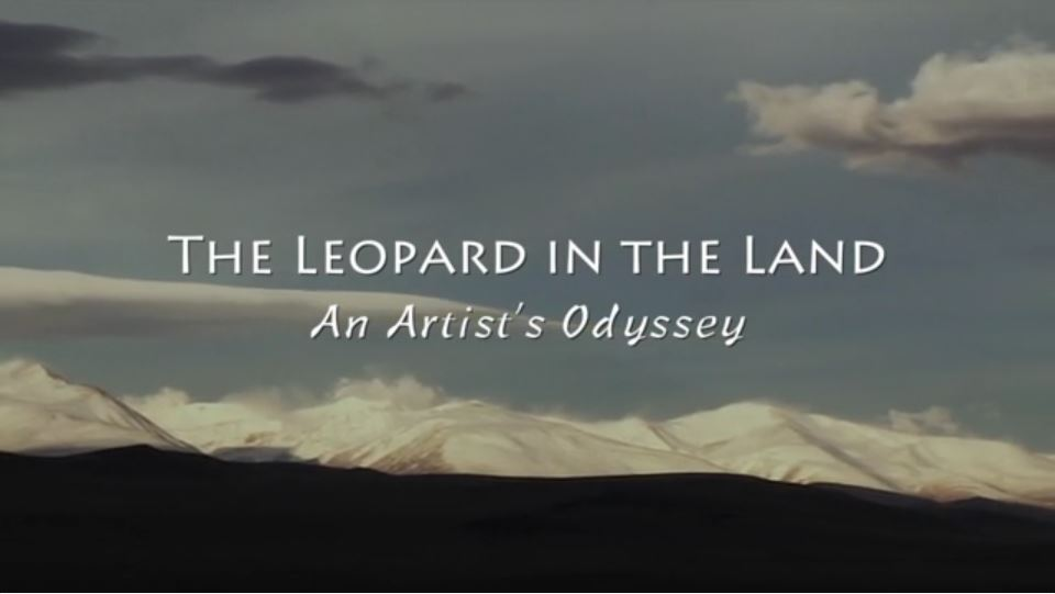 "Words: ""The Leopard in the Land An Artist's Odyssey across a landscape with mountains in the background"