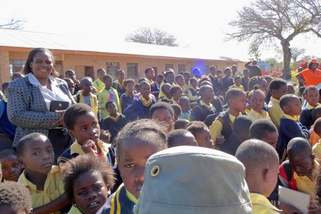 Princess Kabello surrounded by audience of children