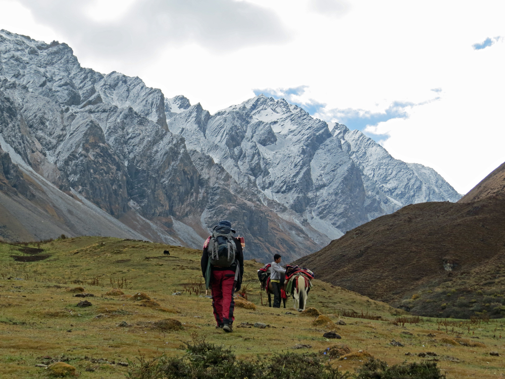 People hiking with mountains in background