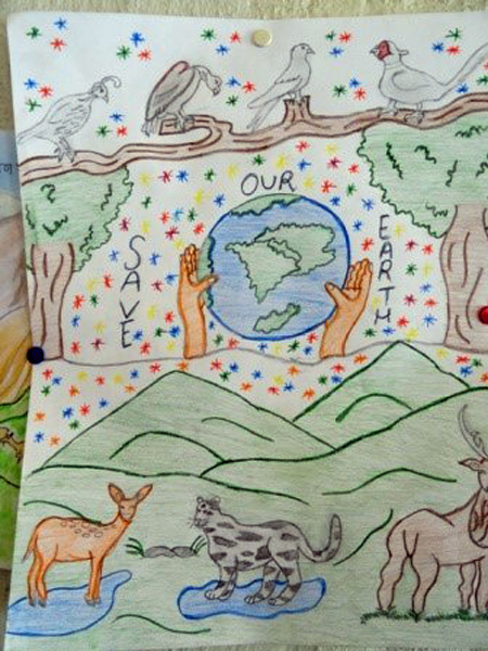 Painting of Earth with human hands embracing it and animals in the foreground