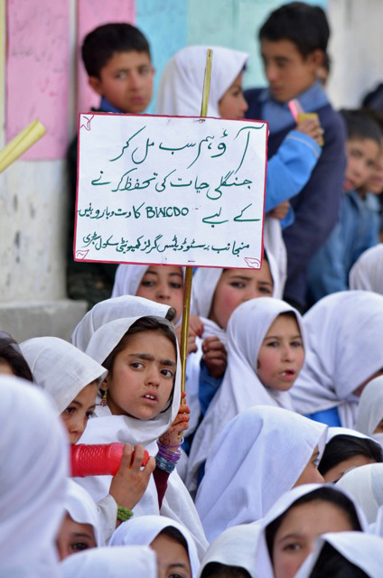 Young girls with sign