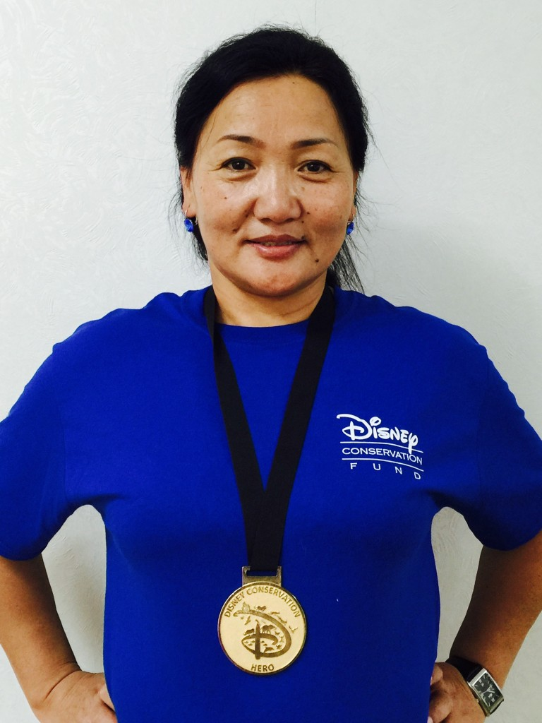 Close-up of Tunga wearing royal blue Disney Conservation Fund tshirt and Hero medal around her neck