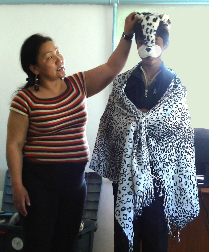 Tunga with a student wearing a snow leopard print shawl and mask