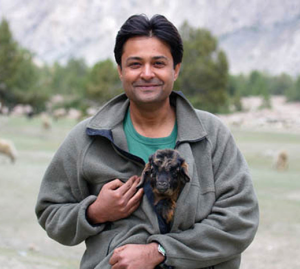 Shafqat Hussain warming a goat kid