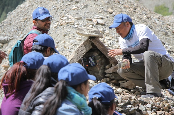 Snow Leopard Scouts learning about camera trap technology Nepal